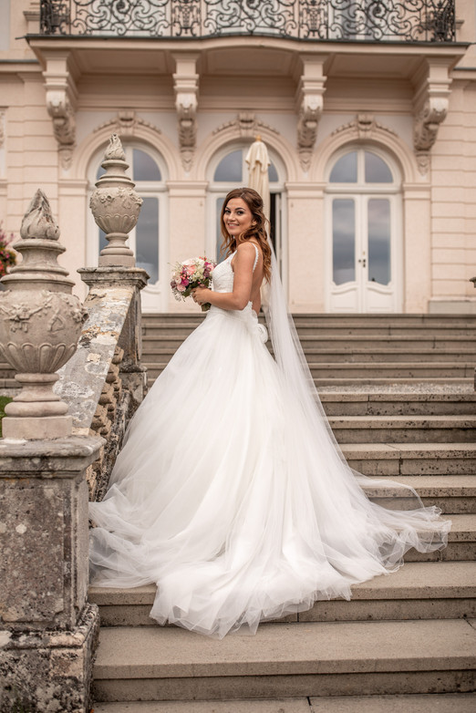 portrait from the bride in white on stairs