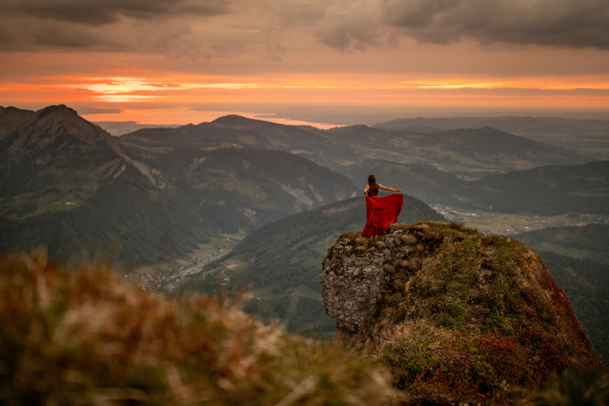 epic photo of a red dress on a mountaintop