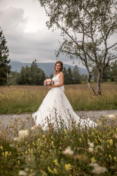 bridal in white wedding dress in nature on the way to the wedding