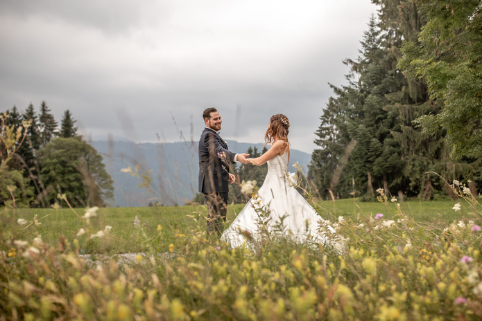 bridal pair dancing in nature in front of trees - wedding pictures for a lifetime
