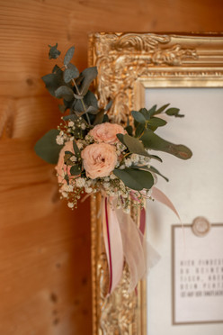 wedding decor - flowers and a golden frame