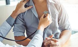 Doctor Measuring arterial blood pressure