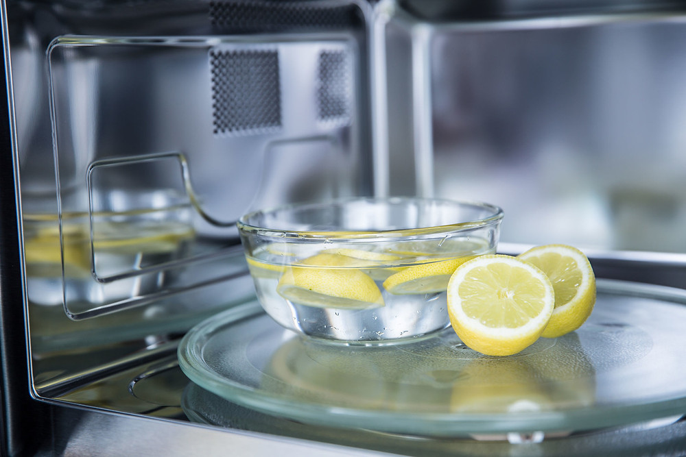 Clean the inside of the microwave with water, lemon and steam