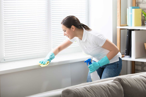 women cleaning window sill white shirt t