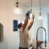 dusting lights in kitchen.jpg