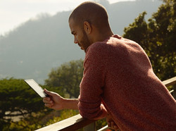 Man reading kindle