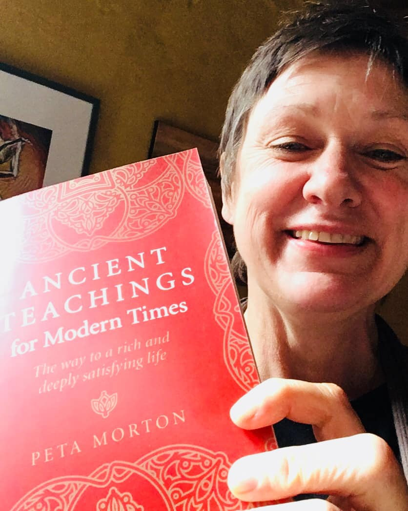 Peta Morton, holding a precious copy of her first book 'Ancient Teachings for Modern Times: the way to a rich and deeply satisfying life.'