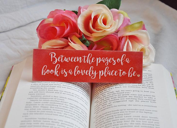 Between The Pages Of A Book Laminated Bookmark