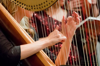 Tiffany Envid harpist hands accompanying choir