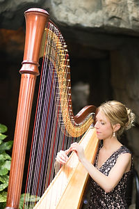 Tiffany Envid playing harp. Picture by Ron Hoen.