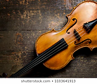 violin-on-rustic-wooden-background-260nw