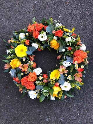 Orange, yellow and white wreath