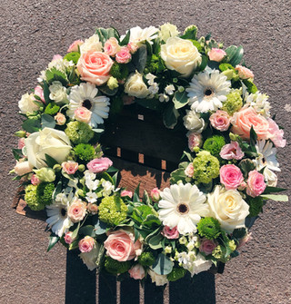 White, green and pink wreath