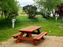 Picnic tables at every site