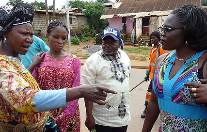 Woman being interviewed during Cameroon