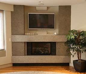 Stone Slab Fireplace incorporating a hidden shade to cover the TV