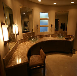 Beautiful curved vanity with glass vessel sinks