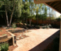 Integrating terracing into this sloping backyard terrain