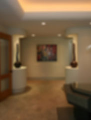 Entry hall design with recessed art and display cases