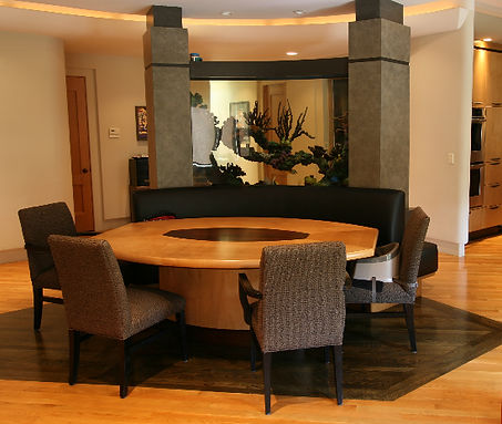 Curved 500 Gal fish tank built into banquette for a great dining experience