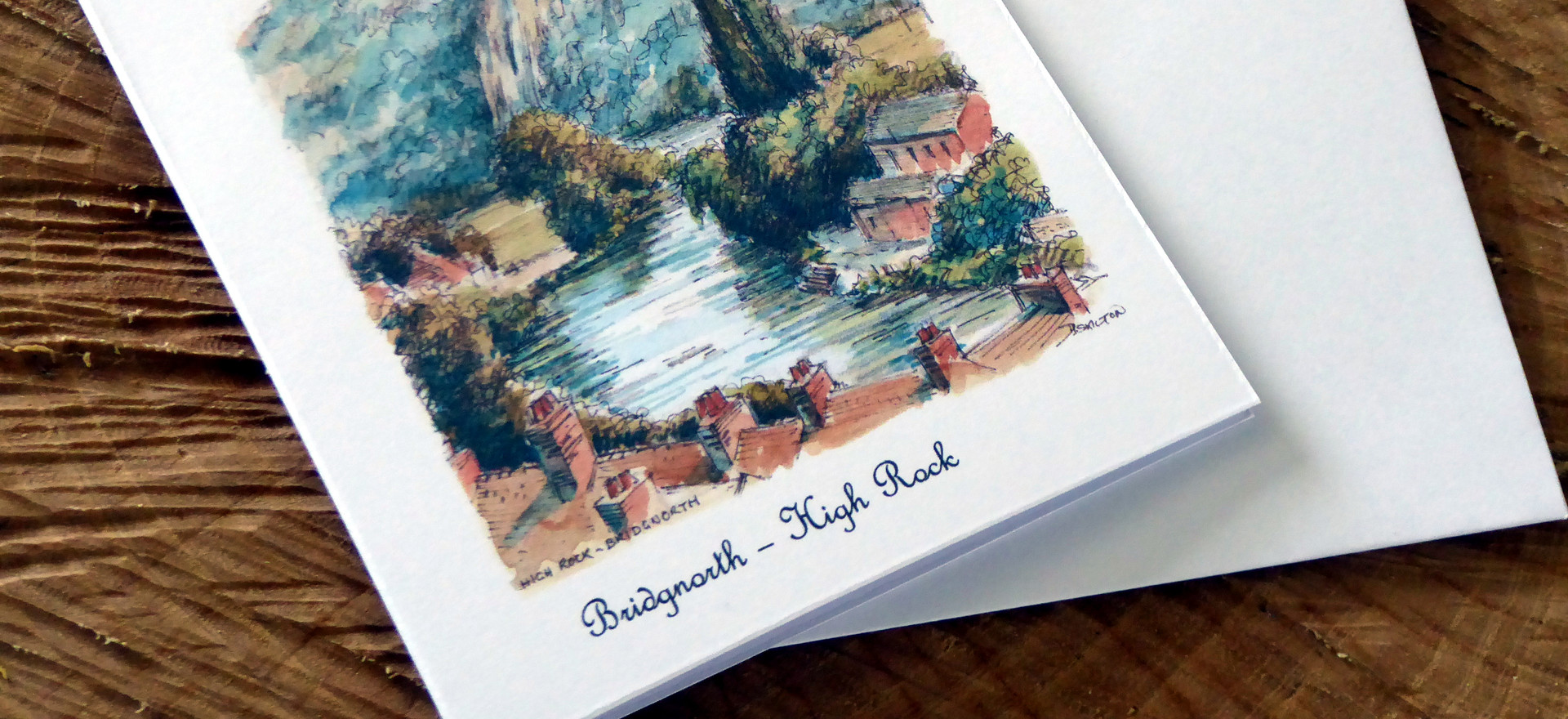 A card featuring a view Bridgnorth's High Rock