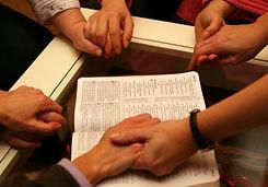 Praying-hands-over-bible-Small4.jpg