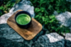 black-cup-on-wooden-board-shallow-focus-