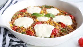 Farro Risotto with blistered tomatoes, corn and burrata