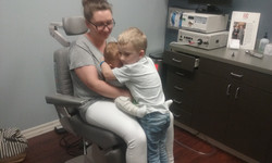 Adam with his mother and brother - doctor office