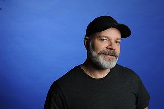 Sonny_D_Blue_Background_Black_Hat.JPG