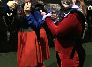 Happy Halloween...(aka Supergirl Shoots at Harley Quinn)