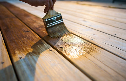 A Painter is Varnishing the Deck