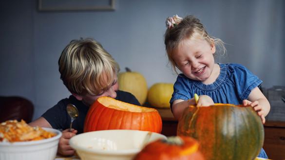 Children Scooping Out Pumpkins