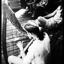 Playing on the boardwalk in Halifax, Nova Scotia, Canada.