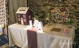 Table décorée pour livre d'or avec urne maison personnalisée réalisée par You Big Day