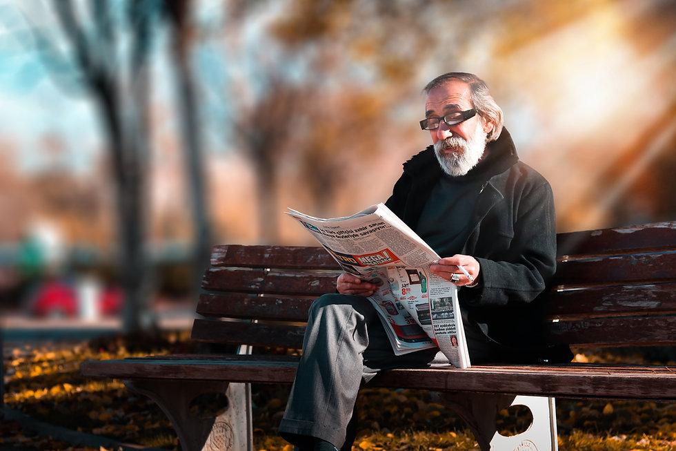 photo-of-man-reading-newspaper-1652340.j