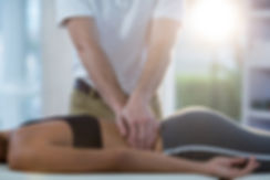 Male physiotherapist giving back massage