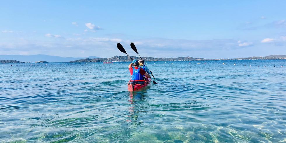 С каяк около остров Амулиани