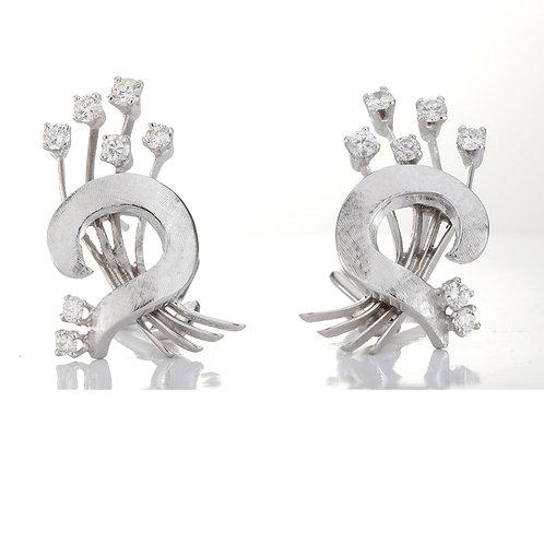 Vintage diamond earrings. 14kt white gold. Est. 0.70 carats round diamonds.