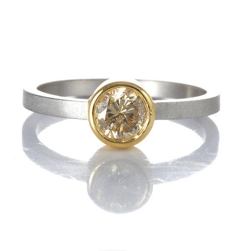 Diamond engagement ring .54 Natural fancy brown round brilliant. Platinum. 22kt.