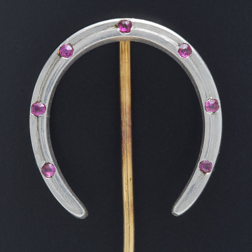 Antique Tiffany & Co. stick pin. Ruby, platinum, 14kt gold lucky horseshoe.