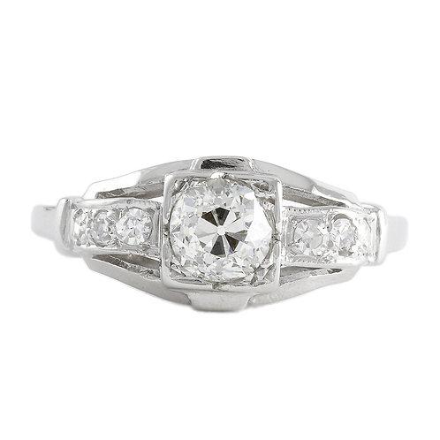 Vintage engagement ring .57 K Si2 old European diamond. Platinum. Art deco.