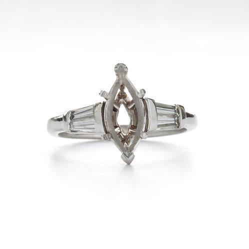Vintage engagement ring setting for Marquise shape. Baguette diamonds, platinum.