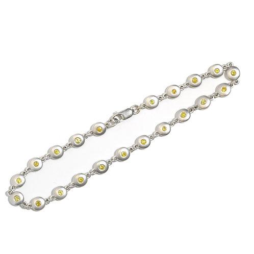 Natural Fancy Yellow diamonds by the inch bracelet. 18kt gold. Original design.