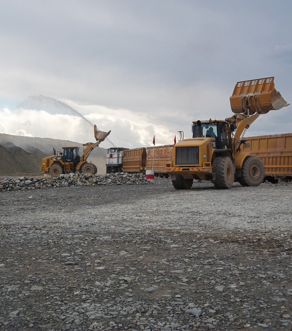 Two CAT 966 Loaders Loading Trains