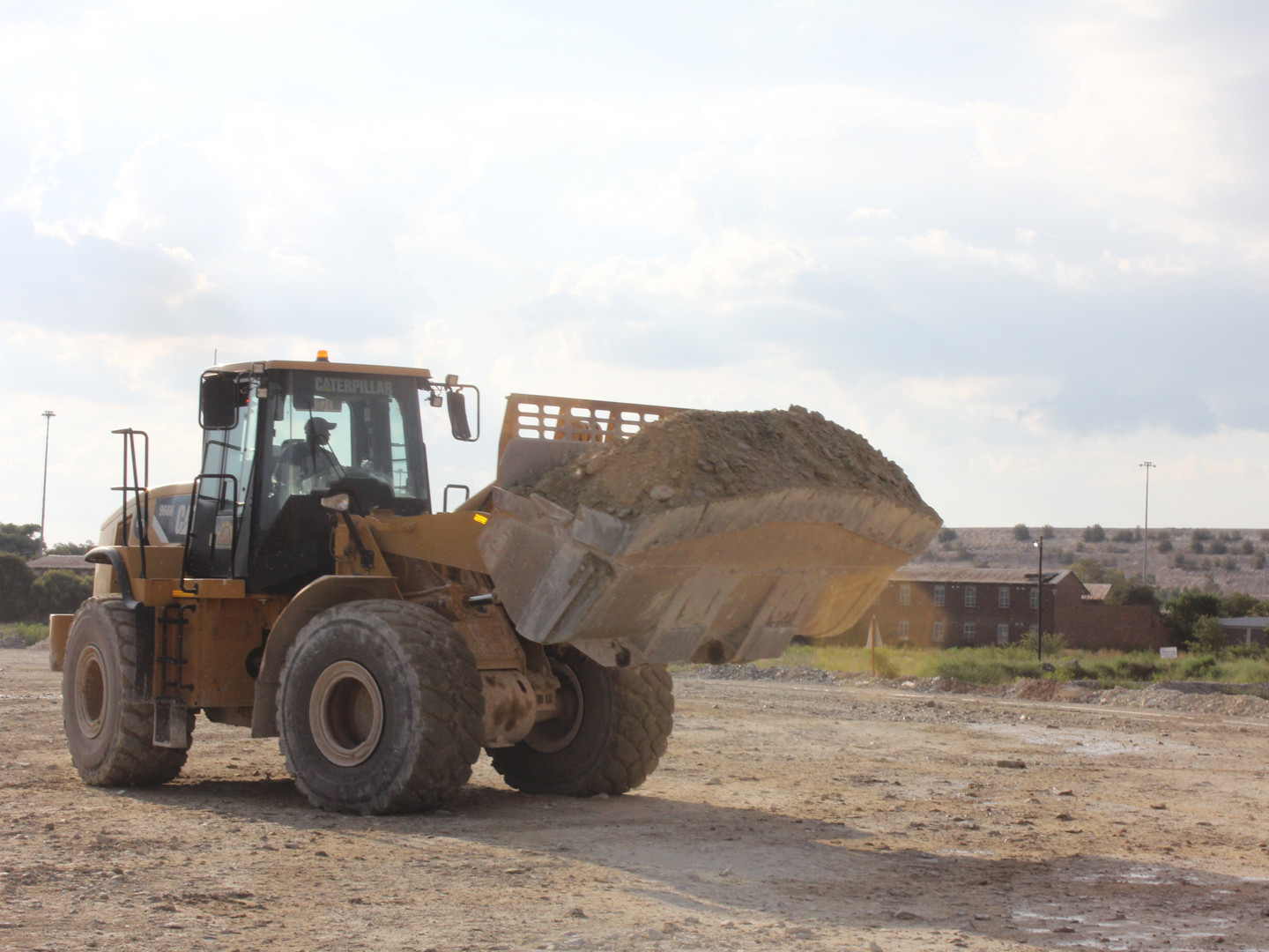 CAT Loader Carrying Sand - West Rand Plant Hire