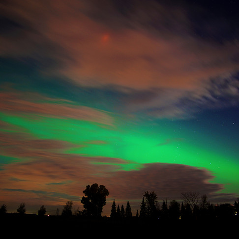 Green are the auroras, red are the clouds and blue is the sky