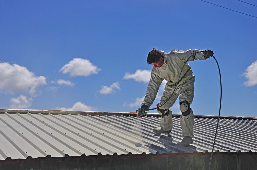man-spraying-a-roof