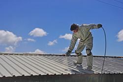 man-spraying-a-roof