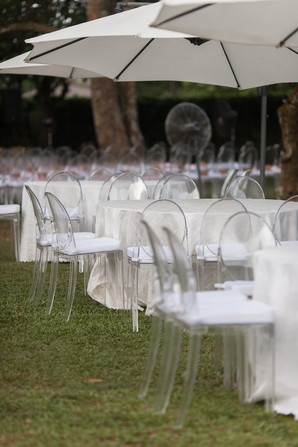 Garden umbrellas with ghost chairs